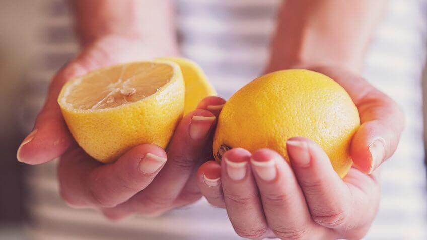woman holding lemons.