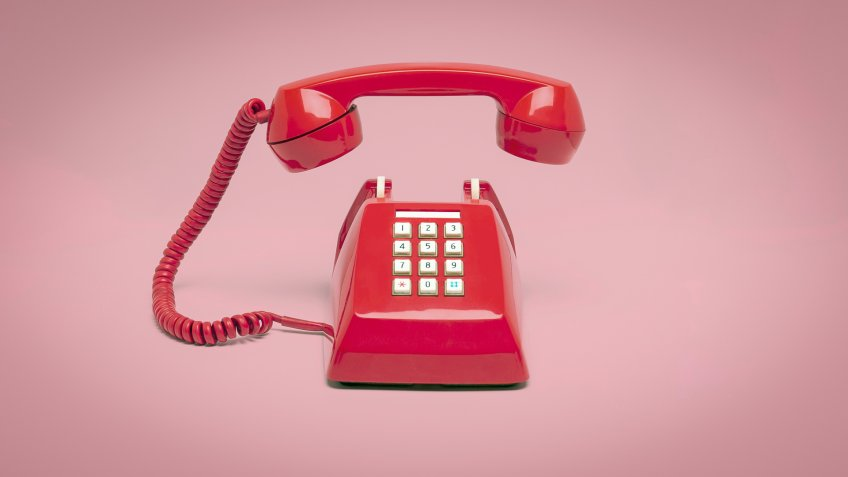 Retro pink telephone on pink background, Vintage style colors.