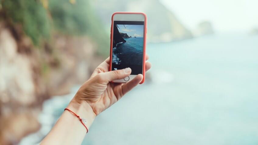 influencer taking photo on smartphone