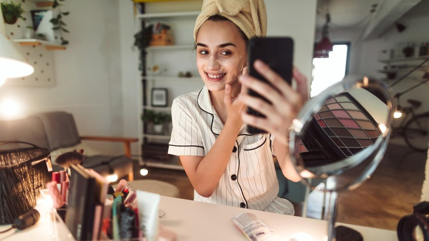 Young woman in her apartment doing her beauty care routine.