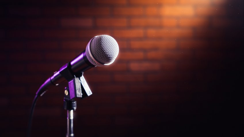 microphone on a stand up comedy stage with reflectors ray, high contrast image - Image.