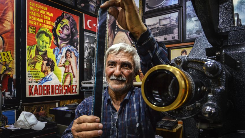 ADANA,TURKEY-MARCH 21: Movie Projectionist inspecting film before show the movie.