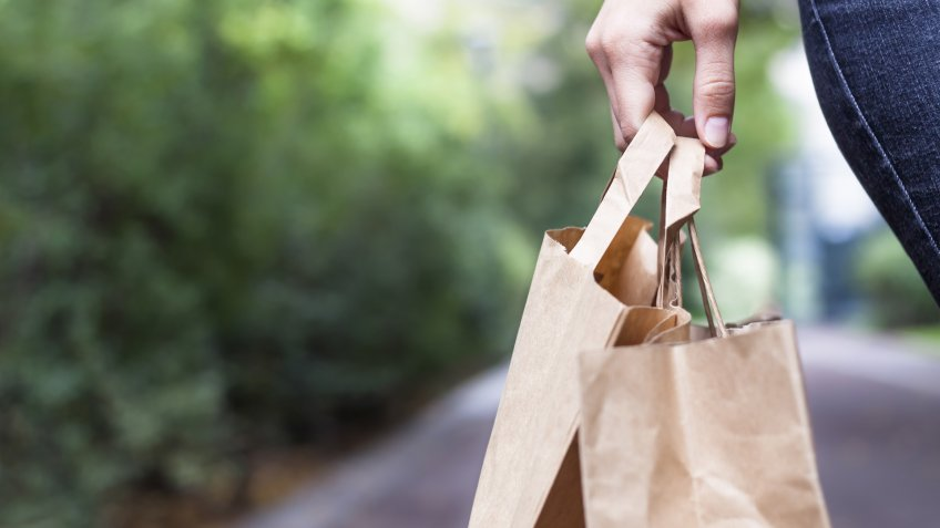 Girl doing ecological shopping with paper bags in hand - Image.