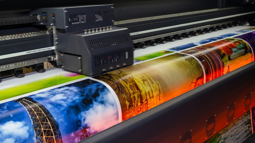 Large format printing machine in operation.