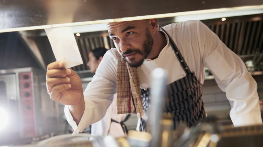 Shot of a chef looking at an order in the kitchenhttp://195.