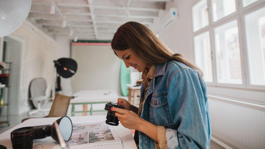 Photographer working in a studio.