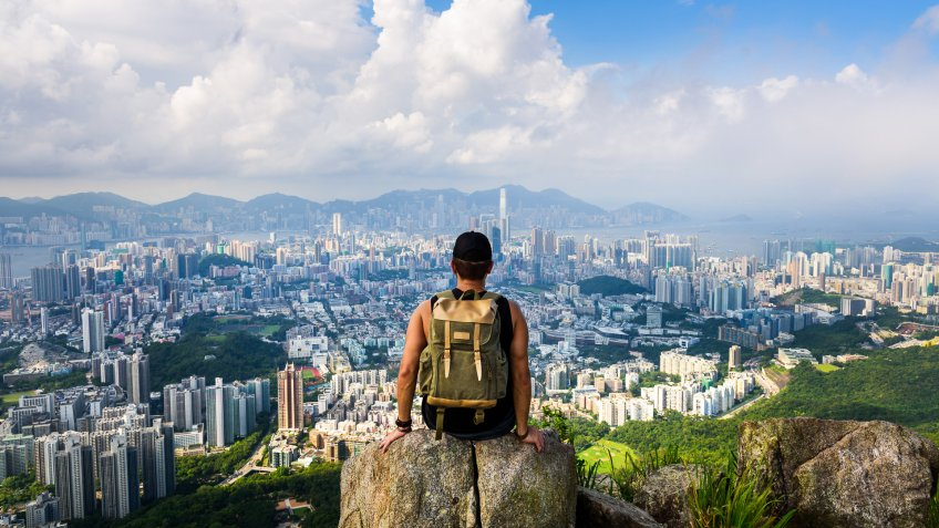 Man enjoying the Hong Kong view from the Lion rock.