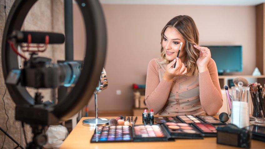 Young vlogger vlogging about make-up.