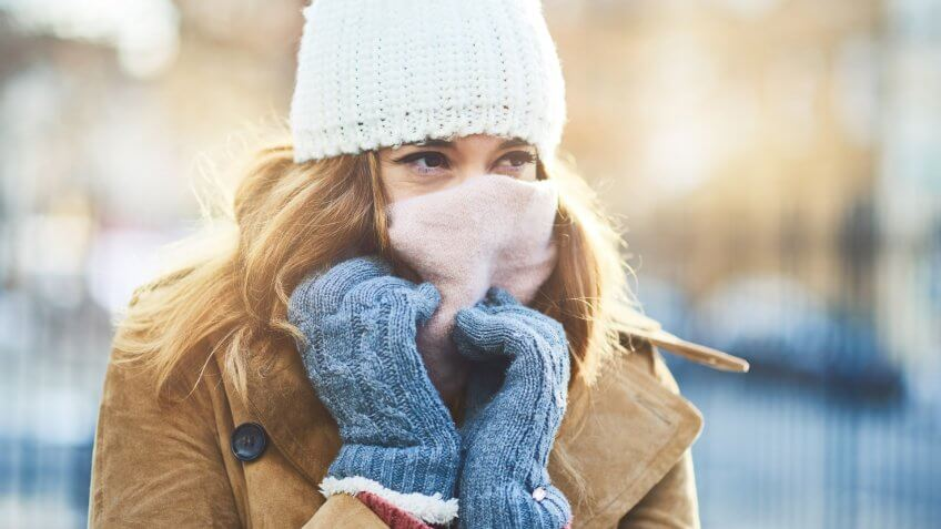 Shot of an attractive young woman enjoying being out in the snow.
