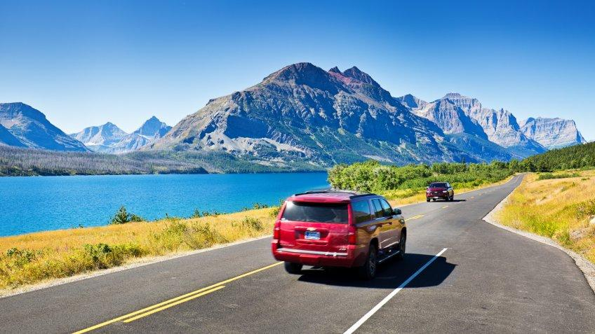 Glacier National Park, Montana, USA - August 4, 2016: Visitors to Glacier National Park touring the park along the breathtaking 'Going To The Sun Road' in cars or in park tour buses.