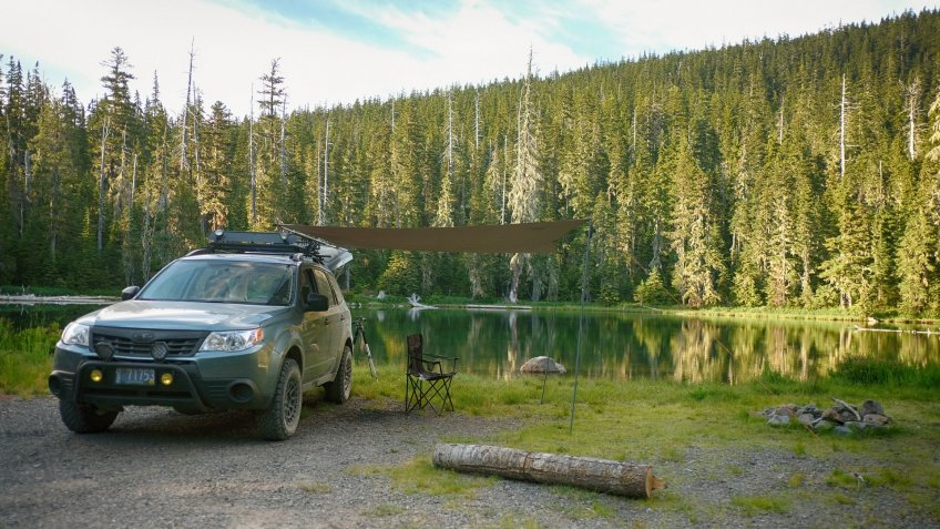 Willamette National Forest, Oregon, USA - July 13, 2018: A Subaru Forester modified for offroad use at a dispersed camping site next to a small lake in the Cascade Range.