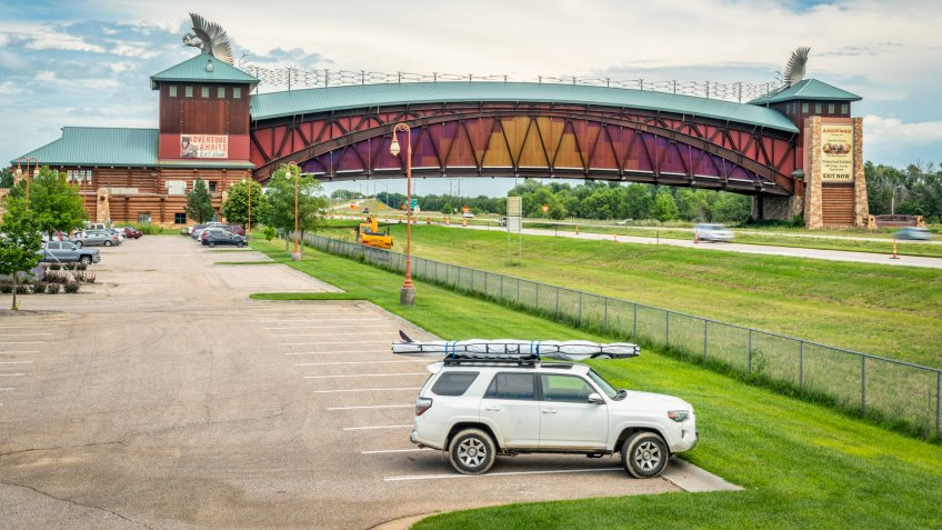 Kearney, NE, USA - July 30, 2018: Toyota 4Runner SUV (2016 trail model) with a stand up paddleboard on rood racks in front of Great Platte River Road Archway Monument.