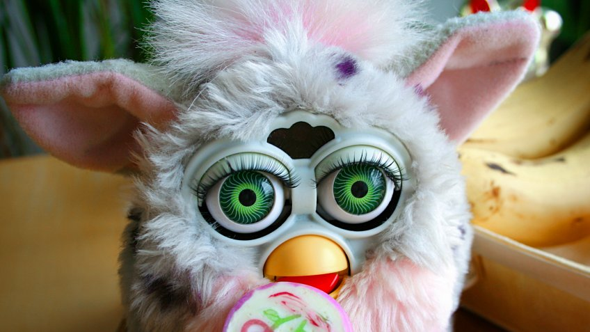 OULU, FINLAND - APRIL 8, 2019: Furby 1998 Leopard With Green Eyes Eating A Lollipop - Image.