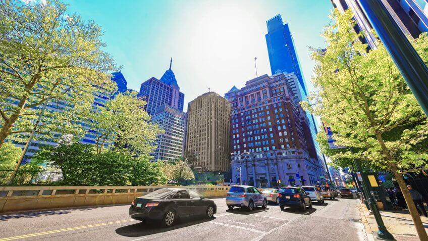 Philadelphia, USA - May 4, 2015: Traffic on JFK boulevard and Penn Center with skyline of skyscrapers in Philadelphia, Pennsylvania, USA.