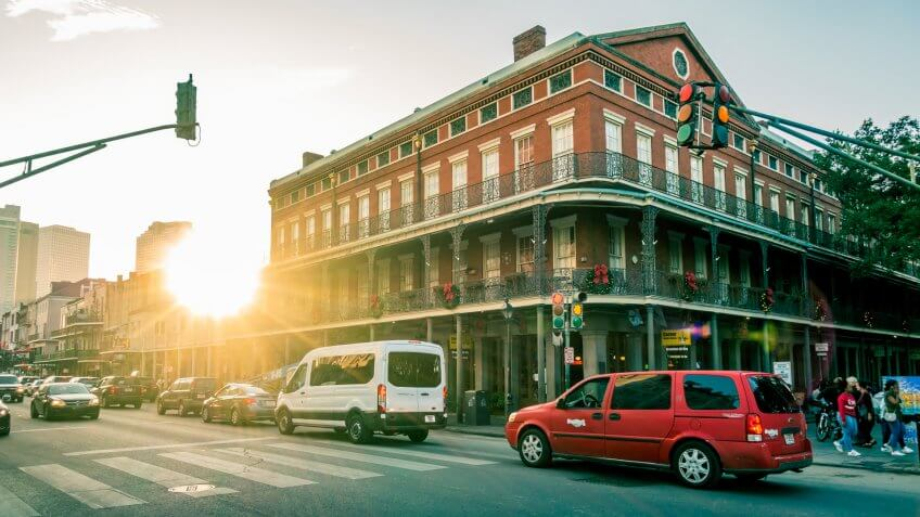 New Orleans - Dec 4, 2017: Afternoon view of brick building with traditional architectural elements with lens flares; at the corner of Decatur and St.