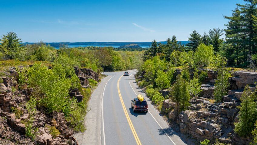 Cars driving on road in Acadia National Park, Maine, USA.