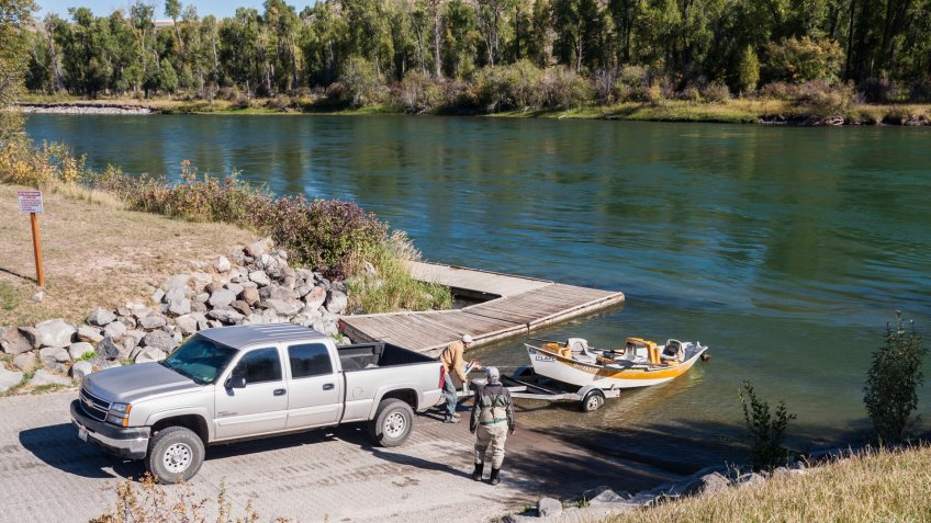 Rigging, Idaho, USA - September 21, 2011: Two men are launching their boat at South Fork Salmon River.