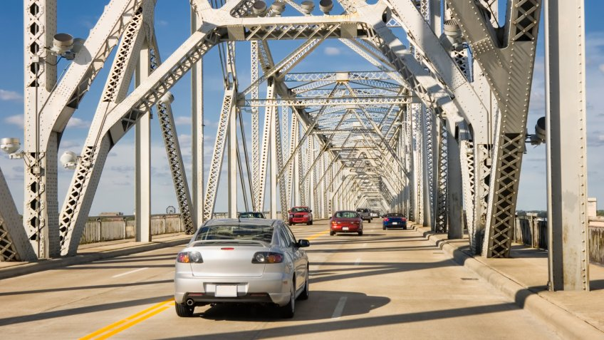 Traffic crossing an interstate highway four lane on a bridge over the Ohio River, Louisville, Kentucky, USA.