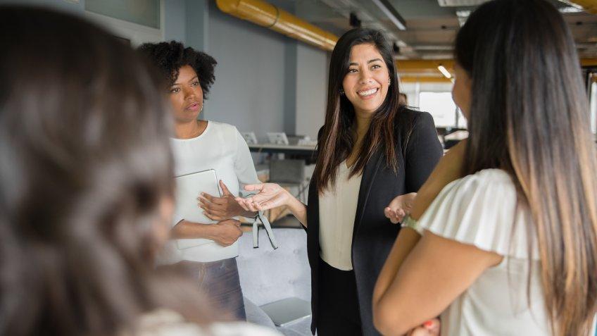 Businesswomen having informal conversation meeting in office.