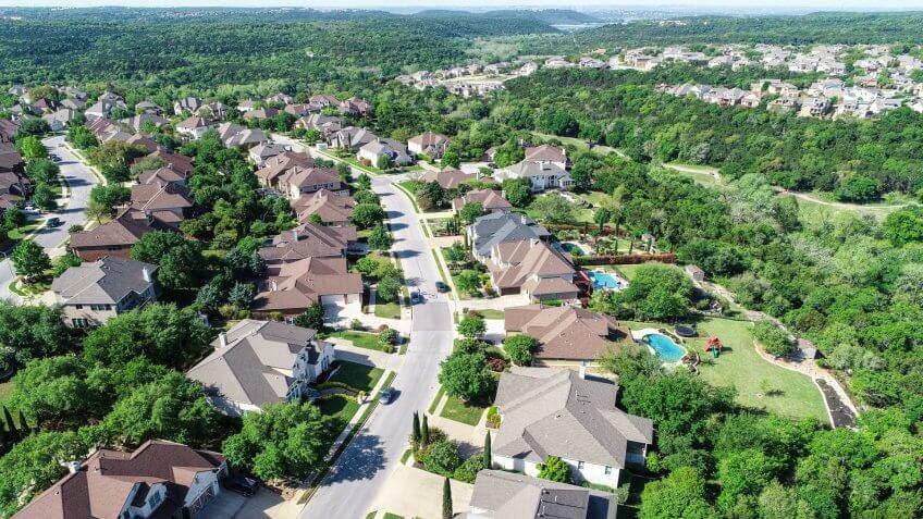 Cedar Park , Texas a suburb of Austin, TX aerial drone amazing view Suburban Luxury Homes in Spring time green aerial drone view of Suburb Houses and suburbia neighborhood near Lake Travis - Image.