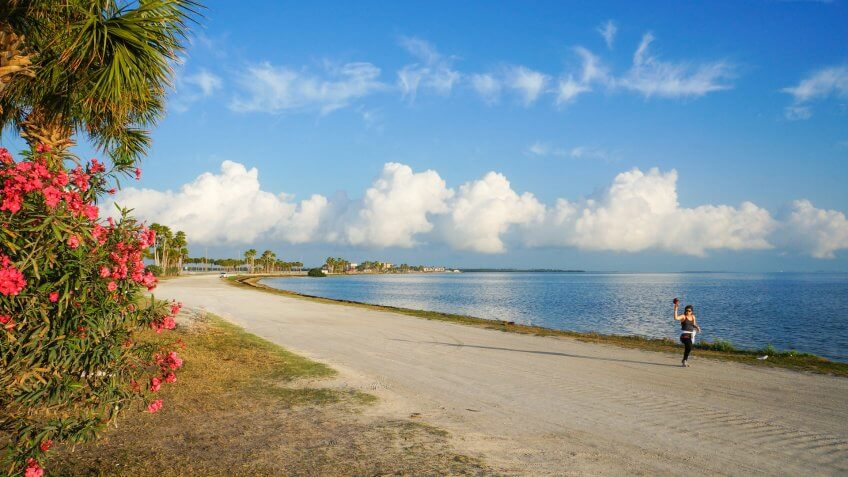 A woman jogging in the morning at Dunedin Causeway, Dunedin, Florida, April 23rd, 2017.