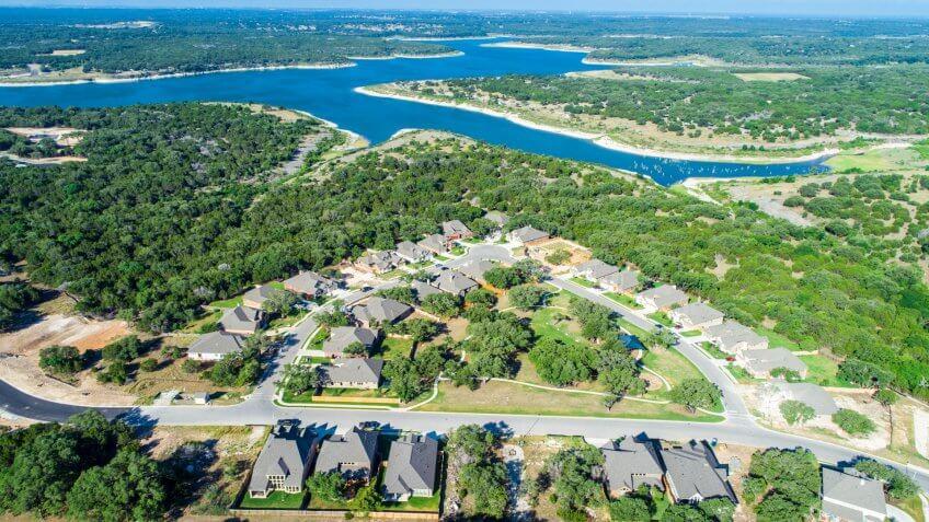 Georgetown , Texas , USA aerial drone suburb neighborhoods  roads come together and take you home - lake property.