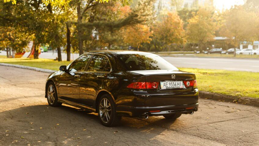 Dnipro, Ukraine - october 01, 2016: Honda Accord dark color on the walkway of Dnipro city street, autumn time.