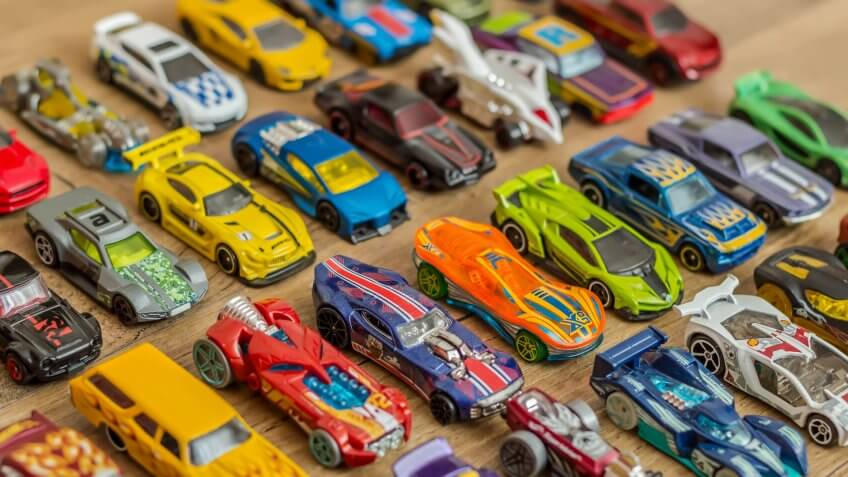 Ivanovo, Russia - June, 2019 : The group of colorful toy car collection on wooden background.