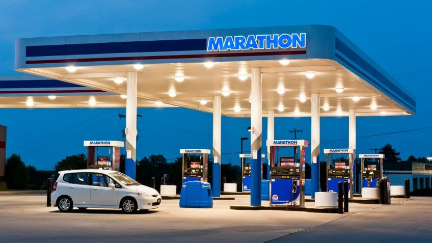 """Maryville, Tennessee, USA - May 9, 2011: An economical Honda Fit takes on another tank of fuel at a Marathon gas station and convenience store."