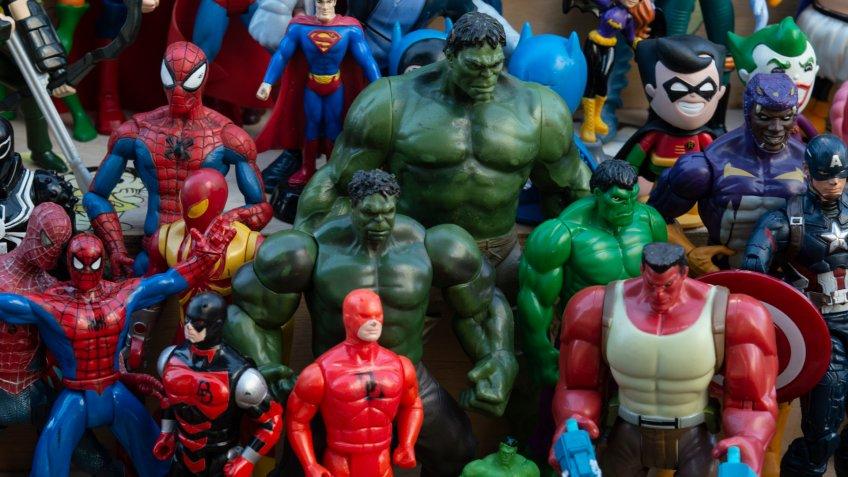 Sao Paulo / Brazil - June 29 2019: Closeup of old toys including superheroes (Huck, Superman, Spiderman, Robin, Batgirl) and cartoon characters (Hello Kitty, Minion, and Disney ones).