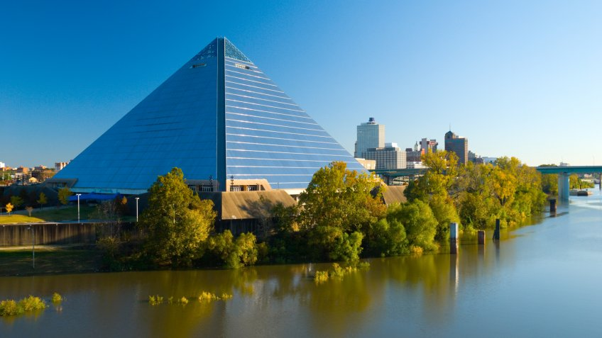 """""""The Pyramid Arena landmark building in Memphis, with the Memphis Downtown skyline in the background and Wolf River in the foreground."""