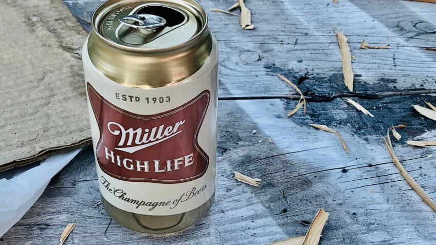 marinette, WI/ USA - February 5, 2019: open can of Miller high life beer can be placed on a wooden table.
