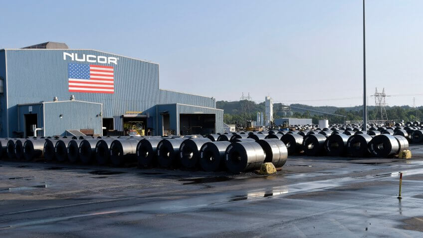 Mandatory Credit: Photo by Timothy D Easley/AP/Shutterstock (9933311c)Rolls of steel are stored outside the rolling facility and await shipment at the NUCOR Steel Gallatin plant, in Ghent, Ky.