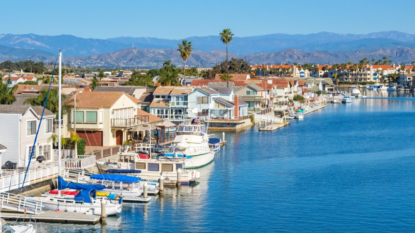 Houses on the waterfront in Oxnard, California, USA on a sunny day.