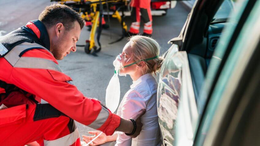 Male Paramedic Helping Injured Woman.