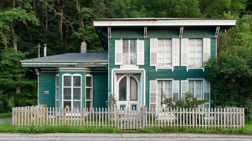 Green house in front of trees in Milford, Pennsylvania - Image.