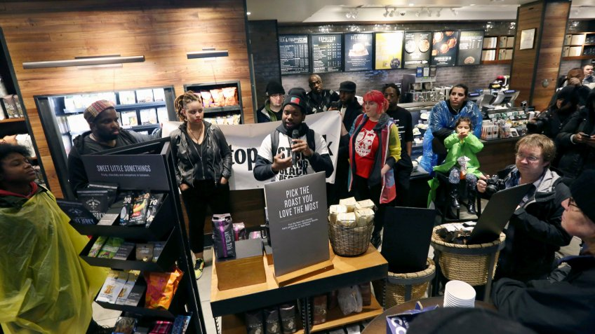 Mandatory Credit: Photo by Jacqueline Larma/AP/Shutterstock (9633941c)Demonstrators occupy the Starbucks that has become the center of protests, in Philadelphia.