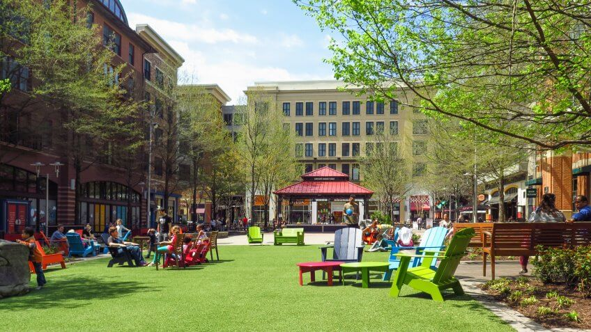 Rockville, Maryland / USA - April 2019: People enjoying the market square in the Rockville Town Center.