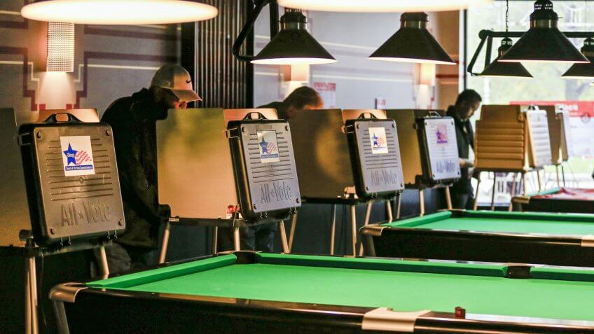 Voters Mark Their Paper Ballots Near a Row of Pool Tables at Pressure Billiards and Cafe in Chicago Illinois
