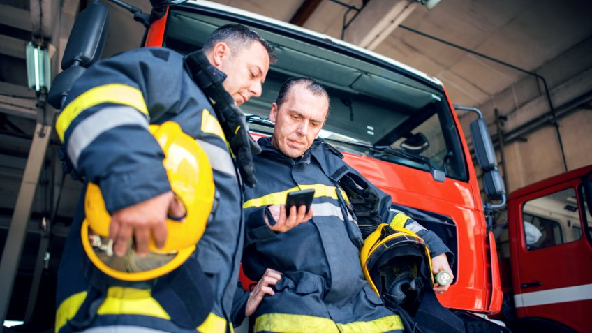 Firefighters using smart phone.