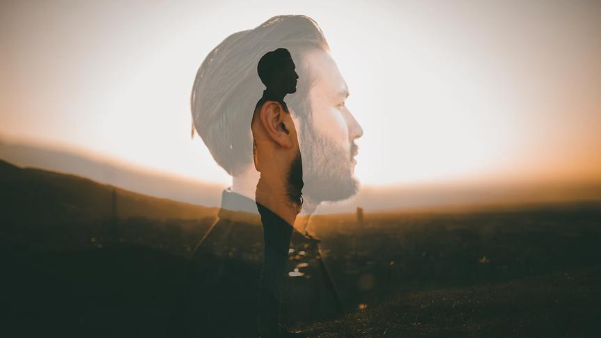 Portrait of a hipster with double exposure technique.