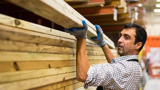 mature man Working at a timber/lumber warehouse.
