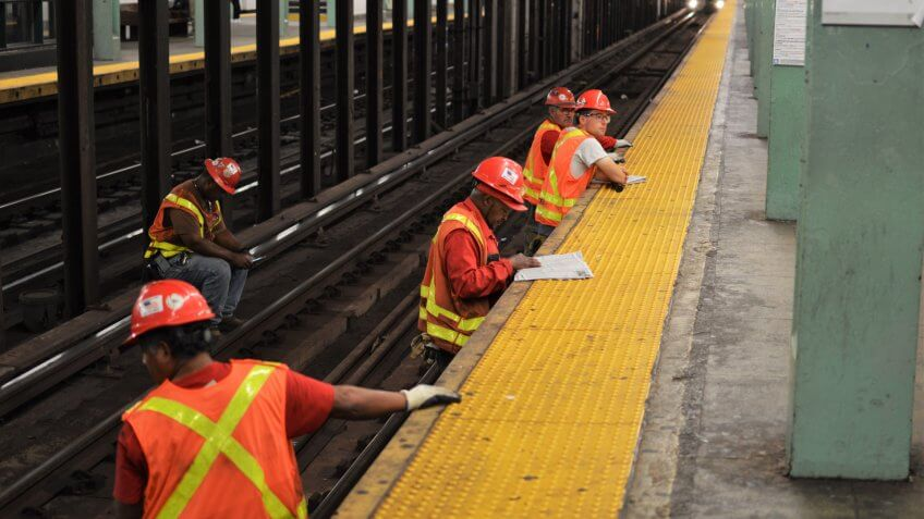 Forest Hills, NY/ USA: 9-12-18- New York Subway MTA Worker Repairing and Working on Train Tracks Service Renovation.