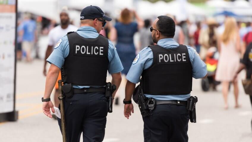 Chicago, USA - Jul 12, 2018: Police at the famous Chicago Taste festival  late in the day in Grant Park.