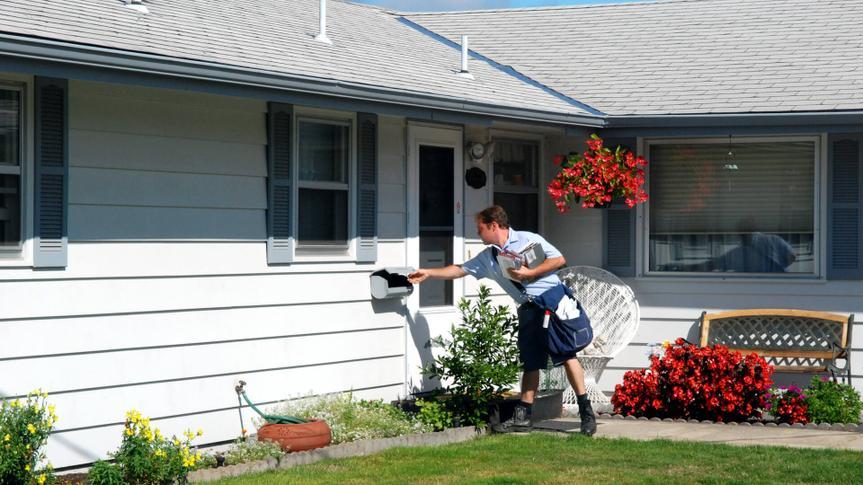 A mailman delivering mail.