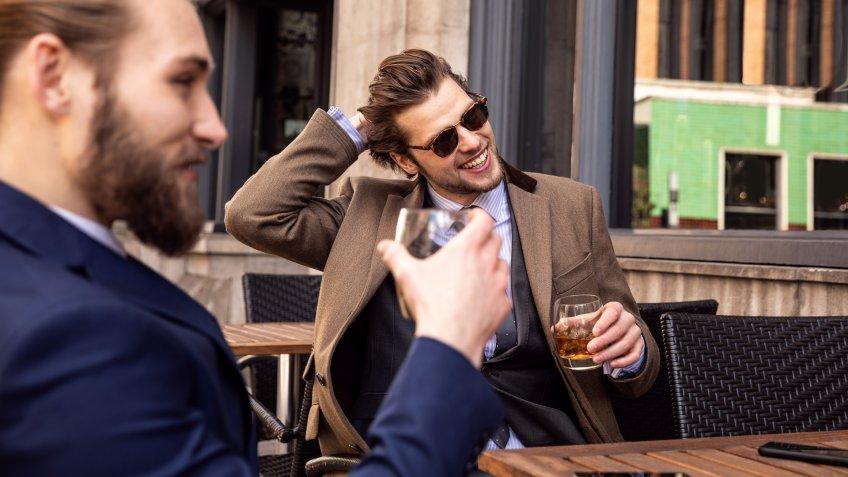 Business break - Two young businessmen taking a break in Central London.