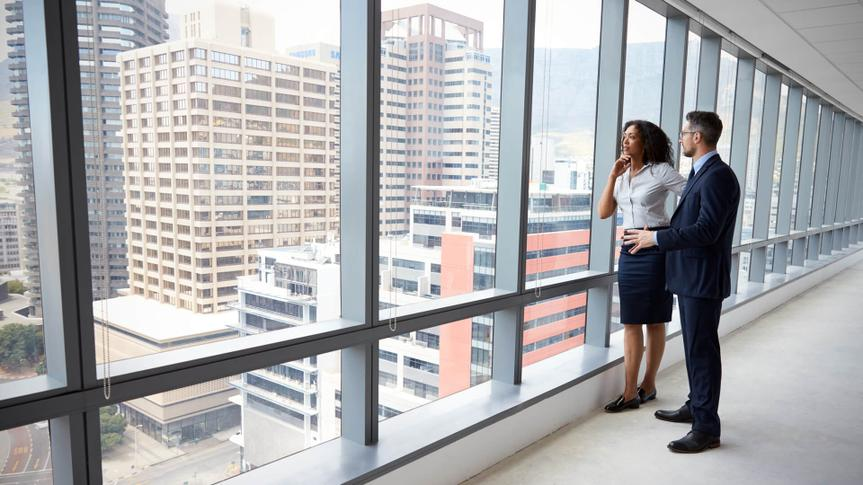 two people looking at commercial real estate