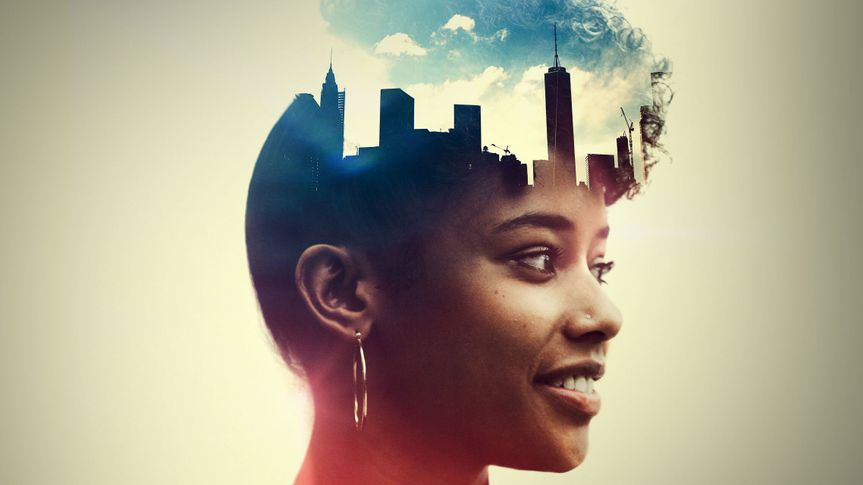 The profile of a woman's head, a New York City skyline double exposed with the image.