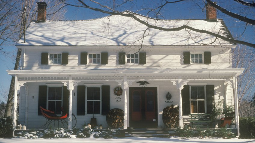 WOODSTOCK, NEW YORK - CIRCA 1980's: Snow covered two-story home at Christmas, Woodstock, NY - Image.