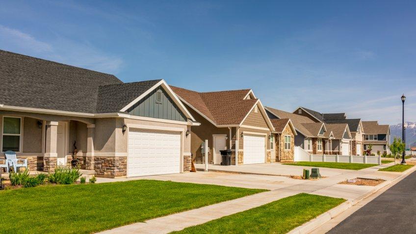 A modern suburban housing development of large detached bungalows in Utah, USA.